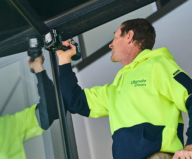tradesman fixing door