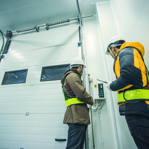 tradesmen checking door controls