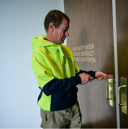 a technician installing a fire door